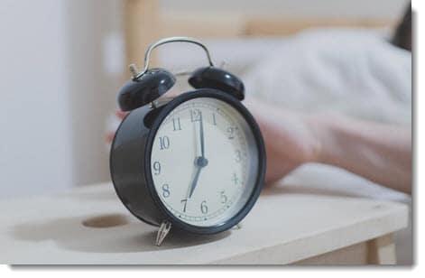 Clock beside bed