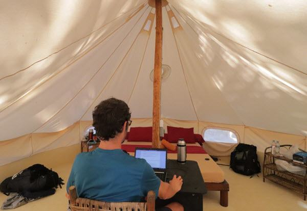Working inside a tepee tent in cambodia